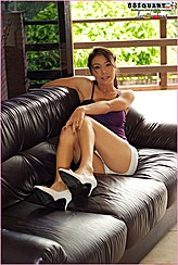Loretta Tang Sitting On Black Couch