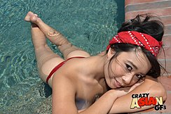 Topless In Pool Resting Head On Her Folded Arms