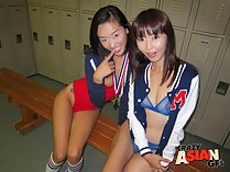 Seated together on bench in locker room