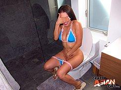 Sitting On Toilet Covering Her Eyes Wearing Bikini Hand Between Her Legs