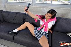Sitting On Black Couch Legs Spread Taking Selfie