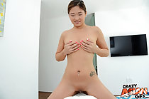 Astride man on bed naked cupping her breasts bald pussy