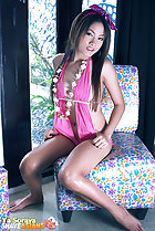 Ya Soraya seated on chair wearing pink swimsuit long hair bare feet