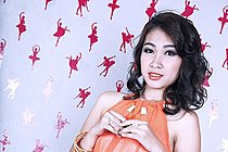 Shaved Amy Strips Orange Dress And Plays With Vibrator