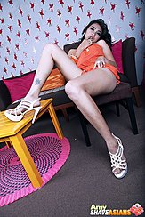 Leaning Back On Chair Foot Raised On Table Wearing High Heels