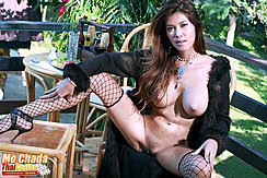 Seated With Her Legs Spread One Leg Up On Table Fishnet Stockings Long Hair Down Over Her Big Breasts