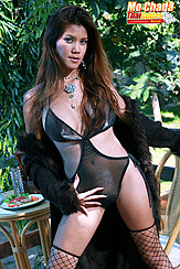Mo Chada Standing In Front Of Lunch Table Long Ahir Down To Her Chest Wearing Fishnet Stockings