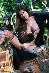 Cupping Her Big Tits Long Hair Legs Spread Exposing Her Pussy Fishnet Stockings