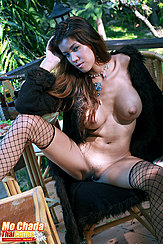 Coat Falling From Her Shoulders Seated Naked Hand In Her Long Hair Flowing Over Her Bare Big Breasts Legs Open Showing Pussy In Fishnet Stockings