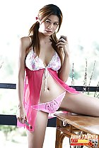 Beside table long hair in pigtails wearing pink panties