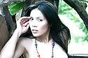 Beauty Tina Phawadee strips bikini and pink shorts outdoors