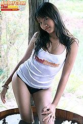 Amber Chan Standing In Water Long Hair Over Her Shoulders In White Top Wearing Panties