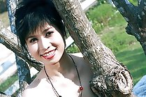 Beau Suni strips outdoors in fishnet stockings baring small tits