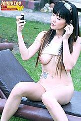 Adjusting Earphone Top Raised Over Her Breasts Long Hair
