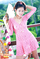 Wearing pink dress holding fan