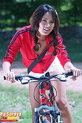 On Bike Ride Leaning Over Handlebars In White Shorts