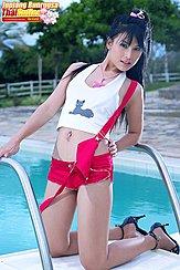 Kneeling Beside Swimming Pool Wearing White Top In Red Shorts High Heels