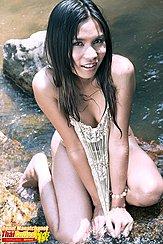 Donut Manatchanok Kneeling In River Tugging Her Top Down