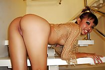 Tauey shows her nice ass and shaved pussy on staircase