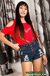 Standing With Hand On Hip Long Hair Over Her Red Top In Denim Shorts