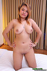 Kneeling Nude On Bed Hands On Hips Necklace Between Her Big Tits Shaved Pussy