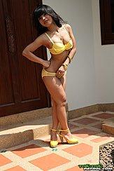 Standing In Bra And Panties Wearing High Heels