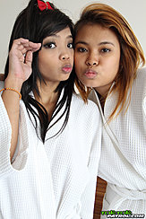Two Girls In White Bath Robes