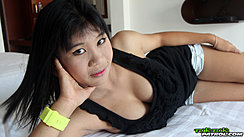 Lying On Bed Wearing Black Top Showing Cleavage