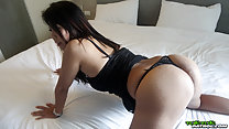 On all fours on bed wearing thong panties