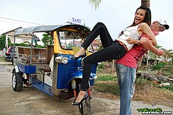 Raised Up Beside Tuktuk Wearing High Heels