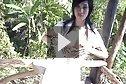 Yoko dancing and stripping white dress outdoors
